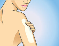 Body lotion on arm. Focus shot of woman applying lotion on arm Royalty Free Stock Photo