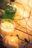 Body lotion aromatic candles session spa Royalty Free Stock Photo