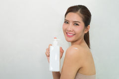 Body lotion, Portrait of Beautiful Young Woman looking at Camera stock images