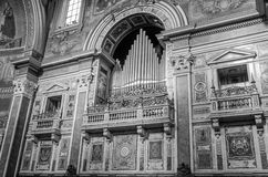 The body in the marble wall and balconies for the VIP box for bishops in Basilica di San Giovanni in Laterano in Rome, capital of Royalty Free Stock Image