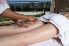 Body massage. Close up shot of full body massage Stock Image
