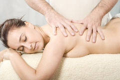 Body massage. Relaxing nice lady having a massage treatement Royalty Free Stock Photos