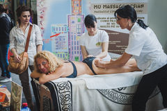 Body massage at Orient Festival in Milan, Italy Royalty Free Stock Photography