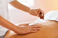 Body massage. Spa therapy. Beauty treatment concept. Skincare, w Stock Photos