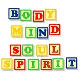 Body mind soul and spirit in color block. Conceptuals texts, body, mind, soul, spirit in different colors block, isolated on white Royalty Free Stock Photo