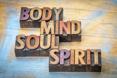 Body, mind, soul and spirit word abstract. Text in vintage letterpress  wood type printing blocks against grunge wood Stock Photos