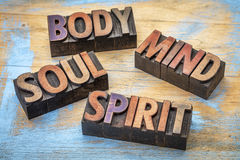 Body, mind, soul and spirit word abstract in wood type. Body, mind, soul and spirit word abstract - text in vintage grunge wood letterpress printing blocks Royalty Free Stock Photo