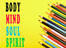 Body,mind,soul,spirit. Words on yellow background Stock Photo