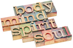 Body, mind, spirit and soul concept in wood type Royalty Free Stock Photo