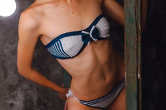 Body of model in a dark  blue with white knitted bikini Stock Photography