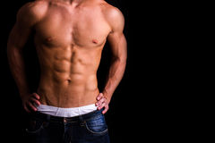 Body of a muscular man against black background Stock Photography