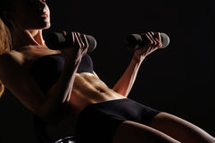 Body Of A Young Woman Working Out Her Abs Stock Images