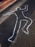 Body outline on road. Painted outline of a person's body on bitumen / asphalt road stock image