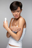 Body Pain. Beautiful Woman Feeling Pain In Arms, Applying Cream Royalty Free Stock Images