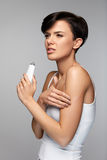 Body Pain. Beautiful Woman Feeling Pain In Arms, Applying Cream Royalty Free Stock Image