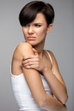 Body Pain. Beautiful Woman Feeling Pain In Shoulders And Arms Stock Image