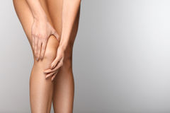 Body Pain. Close-up Of Beautiful Female Body With Pain In Knees. Closeup Of Girl Feeling Joint Pain In Leg. Woman Hands Touching And Massaging Painful Knee Stock Image
