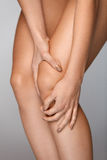 Body Pain. Close-up Of Beautiful Female Body With Pain In Knees Royalty Free Stock Image