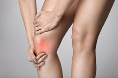 Body Pain. Close-up Of Beautiful Female Body With Pain In Knees. Closeup Of Girl Feeling Joint Pain In Leg. Woman Hands Touching And Massaging Painful Knee Stock Photos