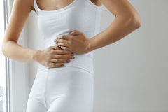 Body Pain. Close Up Of Beautiful Woman Body Having Stomach Ache Stock Images
