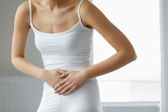 Body Pain. Close Up Of Beautiful Woman Body Having Stomach Ache Royalty Free Stock Photography