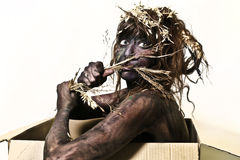 Body painted woman eating a straw Royalty Free Stock Photos