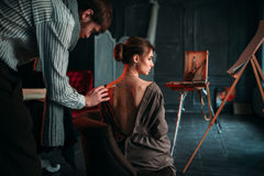 Body painting artwork on womens back Royalty Free Stock Image