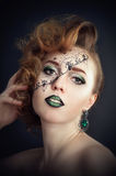 Body painting on the face, hairdresser`s art Royalty Free Stock Photography
