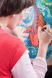 Body-painting a Koi fish (2) Stock Photography