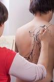 Body-painting : Poissons de Koi (2) Photographie stock