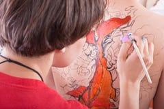 Body-painting sobre para trás Imagens de Stock