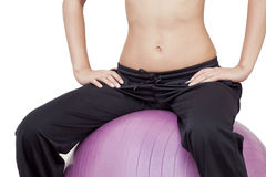 Body Part. Part of a body of the girl sitting on fitness ball Stock Photography