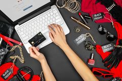 Body part of customer buyers female with debit credit card going to type credit card`s details to buy purchase new fashion goods stock photo