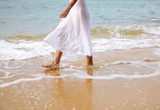Woman walking at beach Royalty Free Stock Images
