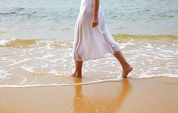 Woman walking at beach Royalty Free Stock Photos