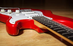 Body part of red 6 string guitar Royalty Free Stock Images
