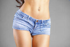 Body part sexy blue shorts. Isolated on gray background Stock Images