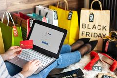 Body part of woman female adult buying making payment on fashion cloth internet online store shop by credit debit card with laptop royalty free stock image