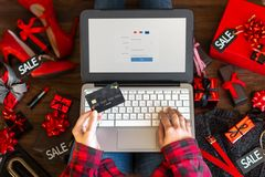 Body part of woman female adult buying making payment on internet online store shop by credit debit card with laptop during black stock photography