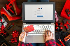 Body part of woman female adult buying making payment on internet online store shop by credit debit card with laptop during black stock photos