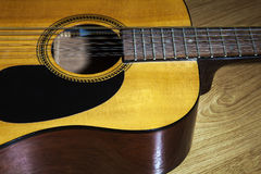 Body part of yellow 12 string guitar Stock Photos