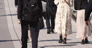 A body parts of walking people at urban city in Shibuya