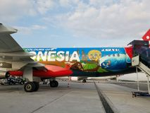 Body of plane Indonesia AirAsia. Painted, picture, special, limited, edition, side royalty free stock image