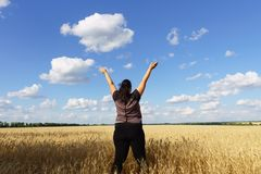 Overweight woman jumping high at sky background stock photos