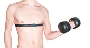 Body,pulse belt and dumbbell. An isolated photo of a athletic mans body with a pulse belt. The man hold a heavy black dumbbell in it left hand Royalty Free Stock Image