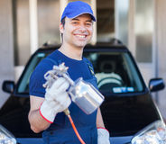 Body repairer holding a spray gun stock photo