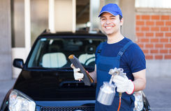 Body repairer holding a spray gun royalty free stock photos