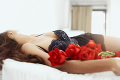 Body and roses Royalty Free Stock Image