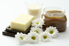 Body scrub. Jar of body scrub with soap and flowers - beauty treatment Stock Photography