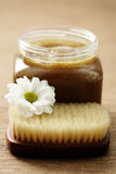 Body scrub. Jar of body scrub and massager - beauty treatment Royalty Free Stock Photography